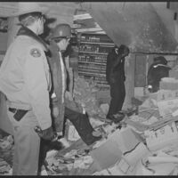 An investigative team views the damage to the Computation Center in Summerfield Hall on Dec. 12