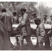 """Pallbearers carrying Rick """"Tiger"""" Dowdell's coffin into church"""