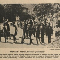 UDK photo showing procession through downtown Lawrence to commemorate the deaths of Rick Dowdell and Nick Rice, July 23