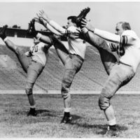 Three players kicking, 1946