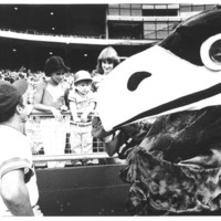 Big Jay and a Kansas City Royals baseball player talking with kids in the stands at a Royals game, 1980