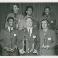 Michael G. Shinn with G.E. basketball teammates, holding award for league championship, 1970.