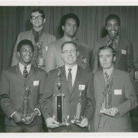 Michael G. Shinn with G.E. basketball teammates, holding award for league championship, 1970.