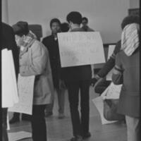 Black Student Union Protester Wearing a Sign in Strong Hall