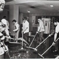 Staff and students cleaning debris after Memorial Union Fire