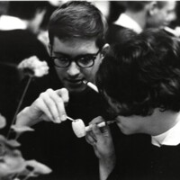 Students light their pipes at 1971 commencement celebration