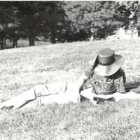 Student reads near Potter lake