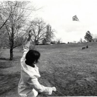Student flies a kite on campus spring 1971<br />