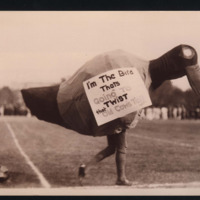 """Jayhawk mascot with a sign: """"I'm The Bird Thats Going To Twist that Old Cow's Tail,"""" 1917"""