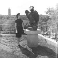 Liz Doughtery standing next to a bronze Jayhawk statue, 1961/62