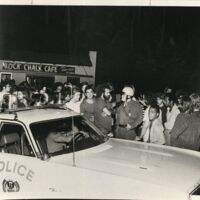 George Kimball speaking with a police officer in front of the Rock Chalk Cafe, July 22
