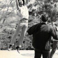Students play frisbee on campus April 1971