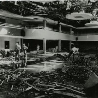 Workmen surveying the damage to the Ballroom after Memorial Union fire