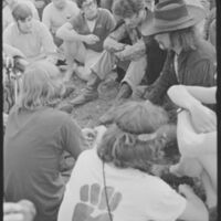 Abbie Hoffman is surrounded by students during the Pleasure Fair on Strike Day, April 8