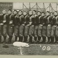 Team with pig mascot, 1909.