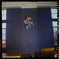 Patrick Bower's mural of a Jayhawk portraying  the School of Business (Advertising), formerly located in the Jayhawk Reading Room of Watson Library, circa 1954