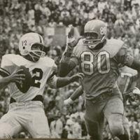 """Mike Shinn, KU's fine sophomore end, gets set to lower the boom on Boston quarterback,"" JAYHAWKER, 1963."