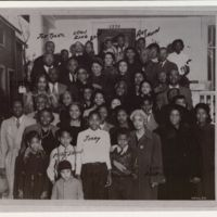 Church gathering at the Tyler family home, with members of the Shinn and Tyler families attending, Topeka, KS, early 1950s.