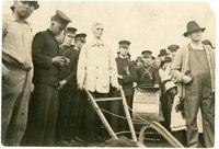 The Chancellor [Lindley] breaking the sod for the Stadium the day Old McCook bleachers were torn down. 1921