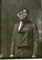 Soldier, Harvey Muenzenmayer, wearing gas mask, Fort Riley, Kansas, 1918