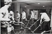Staff and students cleaning debris.jpg