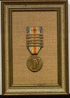 <p>Victory Medal (5 clasps engraved with names of battles) award to Deane Ackers.</p>