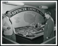 Kenneth Spencer showing an unidentified man a model of a Spencer Chemical Company plant, undated [circa 1950-1959]