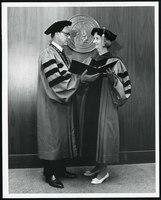 Photograph, Helen receiving her award from KU Chancellor W. Clarke Wescoe, June 3, 1968