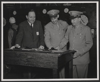 Kenneth Spencer and two unidentified military officers at Jayhawk Ordnance Works, undated [circa 1943-1946]