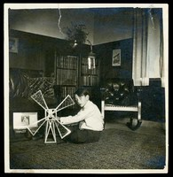 "Kenneth S. Spencer with toy (description on the back: ""the beginning of an engineer"")"
