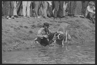 1970 Student Strike Day Photo of student with dog by Potter Lake